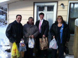 Dr Bret Hartman, Art Bonito, Rob DiCerbo and Sue Bolleen delivering food to the Star of the Sea pantry.