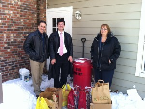 Dr Bret Hartman, Rob DiCerbo and Sue Bolleen delivering food to the New Hope pantry.
